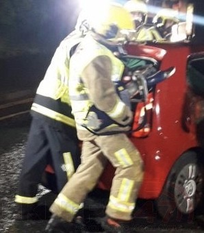 fire crews free trapped people from m20 collision using cutting equipment