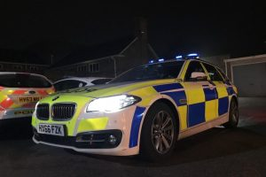 two arrested after jcb ploughed in to hedge