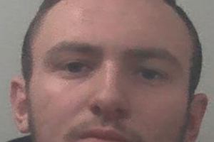 a disqualified driver who drove at three times the speed limit through a town centre has been jailed for over a year