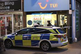 robbery investigators have charged a man with two offences following a report cash was stolen from a travel agent in chatham