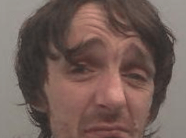 a burglar who was arrested inside a house he had broken into has been jailed