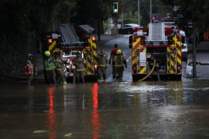fifty firefighters battle to stop water main burst causing thousands of pounds worth of damage