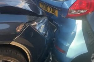 speeding car crashes into stationary vehicles in dover