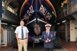 dungeness rnli chairman of management committee honoured for fifty years service