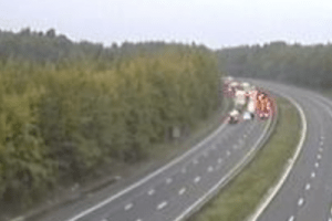 the m25 is closed after a crane has been in collision with a road sweeper