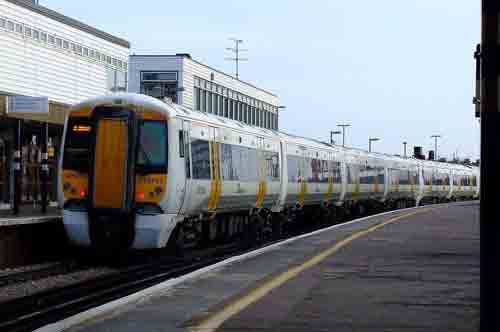 delays as police talk to distressed man on bridge at gillingham station